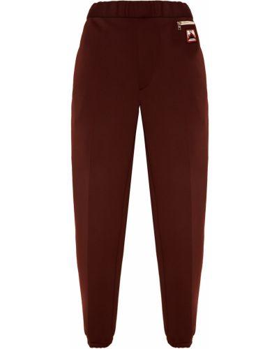 Спортивные брюки с карманами на резинке Prada