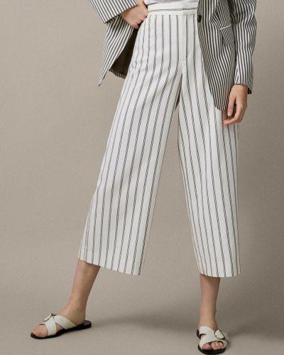 Бежевые брюки в полоску Massimo Dutti