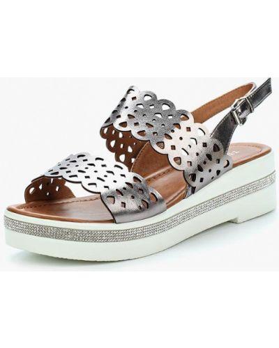 Босоножки на каблуке серебряного цвета T.taccardi