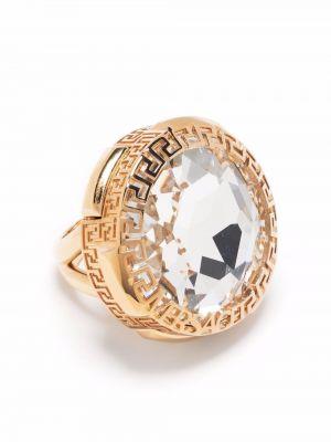С орнаментом желтое кольцо металлическое Versace