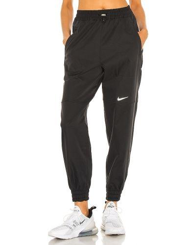 Черные палаццо с карманами металлические Nike