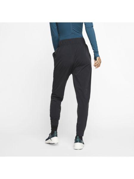 Spodnie Kobza na jogę Nike