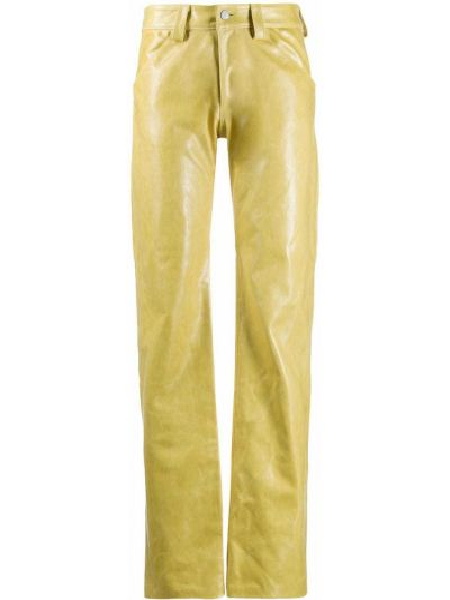 Żółte spodnie skorzane z paskiem Mowalola
