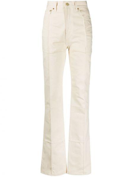 С завышенной талией хлопковые джинсы с высокой посадкой с карманами с заплатками Jacquemus
