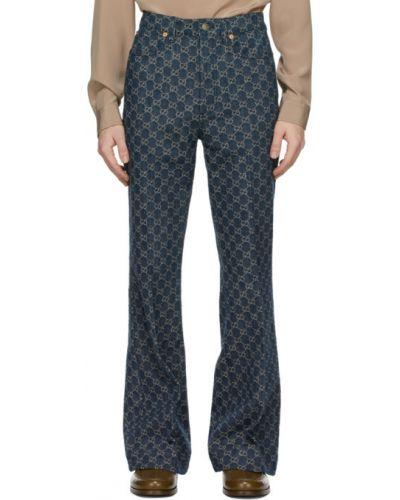 Skórzany czarny jeansy z łatami Gucci