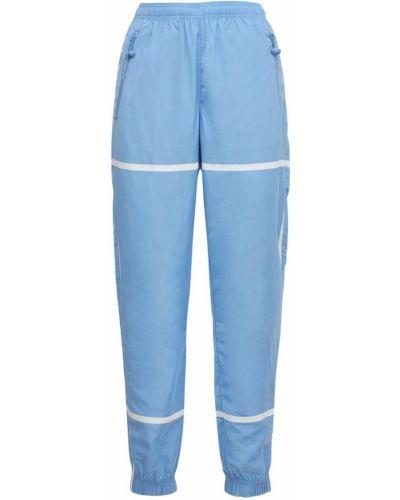 Niebieskie spodnie Adam Selman Sport