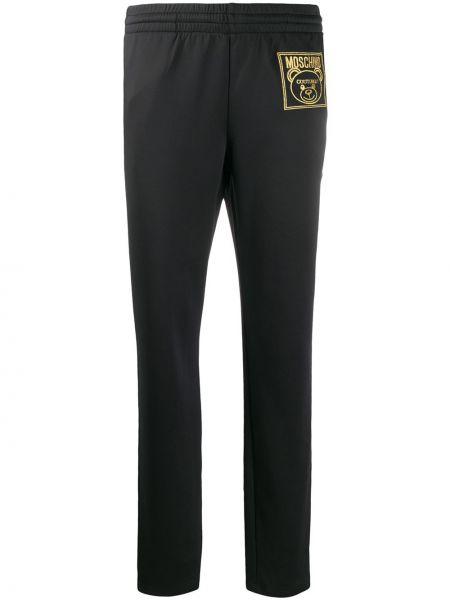 Sportowe spodnie z kieszeniami z haftem Moschino