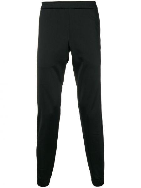 Czarne spodnie wełniane Astrid Andersen