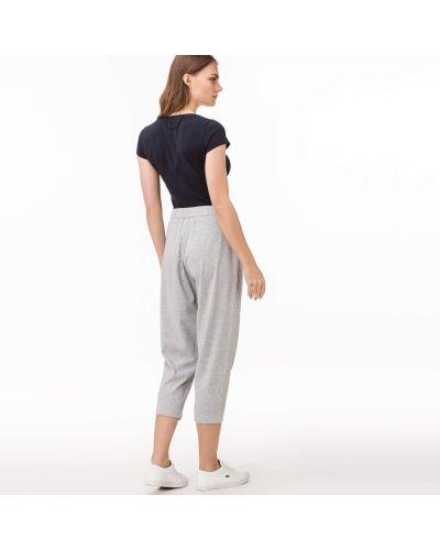 Серые спортивные брюки Lacoste