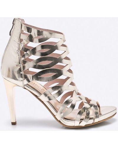 Туфли на высоком каблуке золотого цвета Carinii