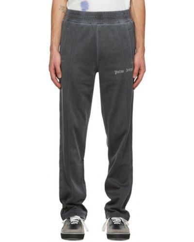 Prosto czarny nylon spodnie o prostym kroju z kieszeniami Palm Angels