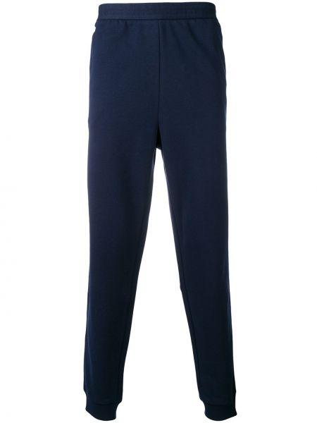 Niebieskie joggery z haftem bawełniane Lacoste