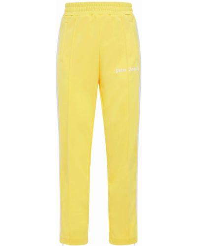 Żółty spodnie w paski z boku na gumce z paskami Palm Angels