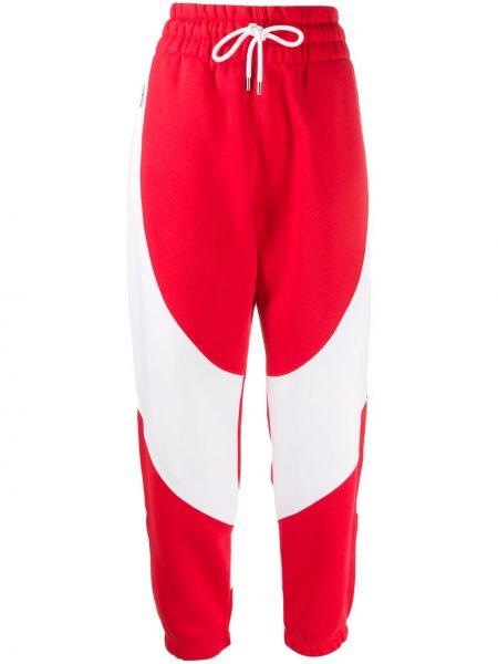 Sportowe spodnie z kieszeniami białe Nike