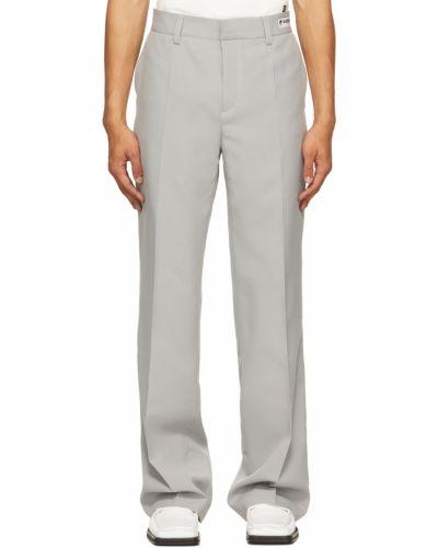 Białe spodnie z paskiem Misbhv