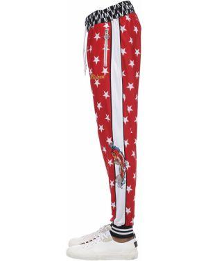 Spodnie w paski z printem Minimal