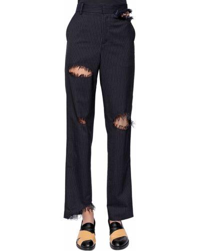 Spodnie wełniane asymetryczne Facetasm