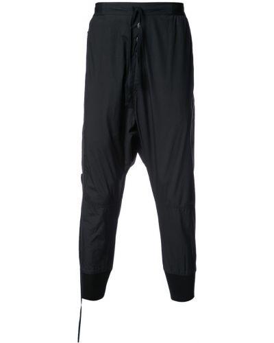 Зауженные брюки с манжетами с заниженным шаговым швом Unravel Project