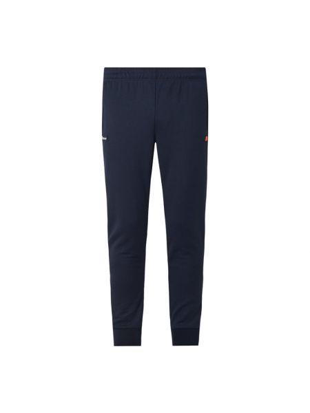Spodni niebieski spodnie na gumce z kieszeniami z zamkiem błyskawicznym Ellesse
