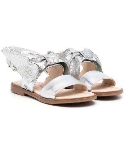 Открытые сандалии с бантом на плоской подошве Florens