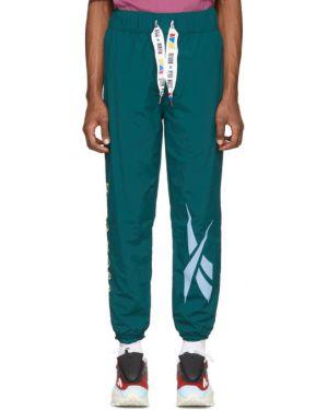Спортивные брюки золотые с манжетами с заплатками с карманами Reebok By Pyer Moss