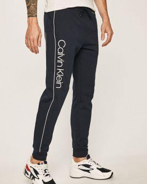 Spodnie długo z kieszeniami Calvin Klein