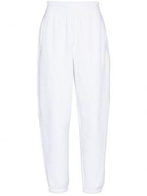 Białe spodnie bawełniane z printem Alexander Wang