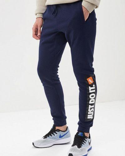 Синие спортивные брюки Nike