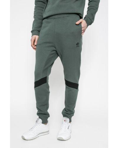 Зауженные брюки на резинке с карманами Reebok