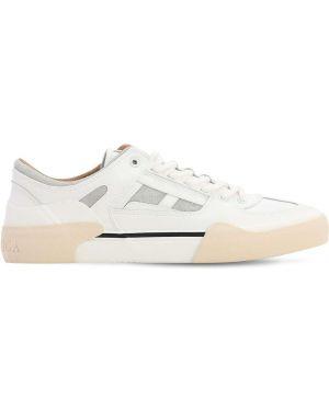 Białe sneakersy skorzane sznurowane Stratica International