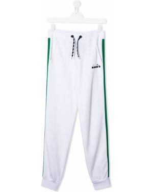 Sportowe spodnie z kieszeniami białe Diadora Junior