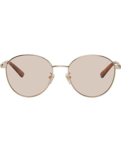 Złote różowe okulary w paski Gucci