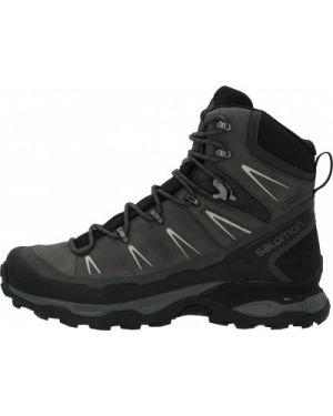Спортивные текстильные черные сапоги на шнуровке Salomon