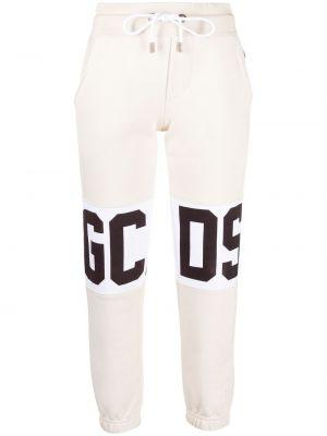 Beżowe spodnie bawełniane z printem Gcds