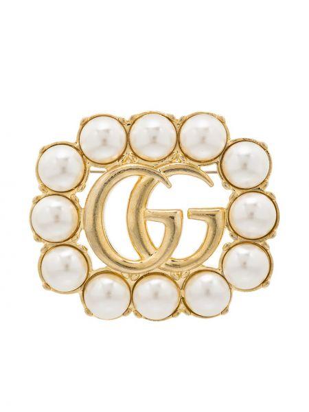 Złota broszka perły Gucci