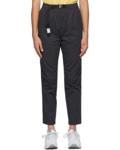 Текстильные черные брюки стрейч с заплатками New Balance