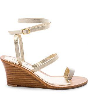 Żółte złote sandały na koturnie Cornetti