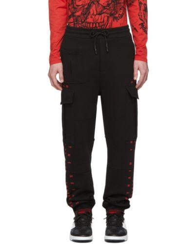 Czarne spodnie w paski Mcq Alexander Mcqueen
