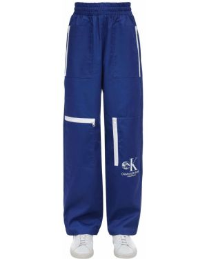 Niebieskie spodnie bawełniane do pracy Calvin Klein Established 1978