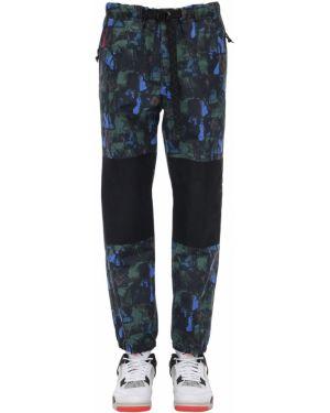 Czarne spodnie z paskiem klamry Nike Acg